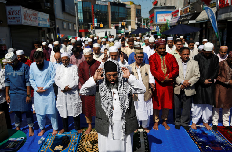 Image: Muslim men attend Eid al-Fitr prayers to mark the end of the holy fasting month of Ramadan in the Queens borough of New York