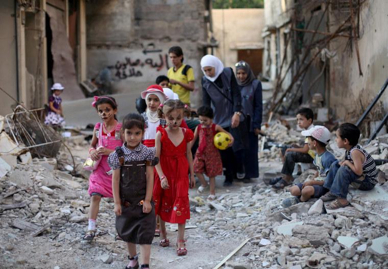 Image: SYRIA-CONFLICT-RELIGION-ISLAM-EID