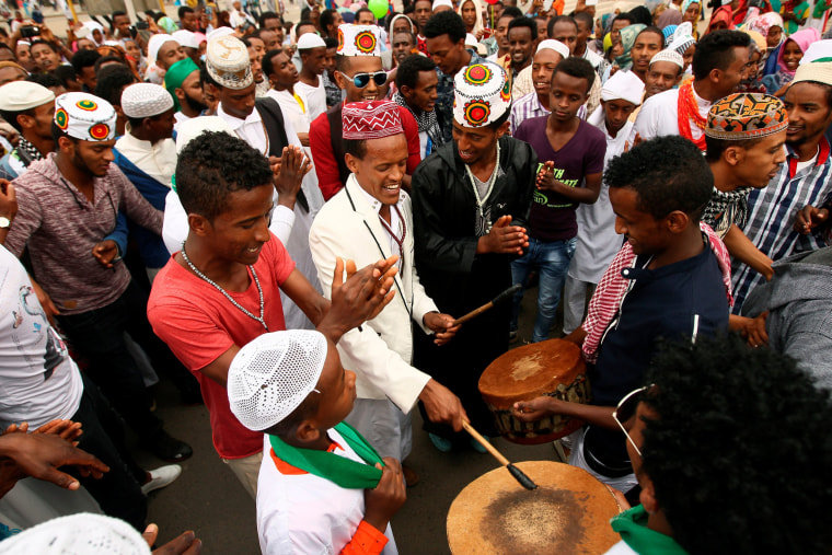 Image: Muslim men sing after attending Eid al-Fitr prayers to mark the end of the holy fasting month of Ramadan in Addis Ababa