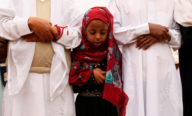 Image: A Muslim girl attends Eid al-Fitr prayers to mark the end of the holy fasting month of Ramadan in Addis Ababa