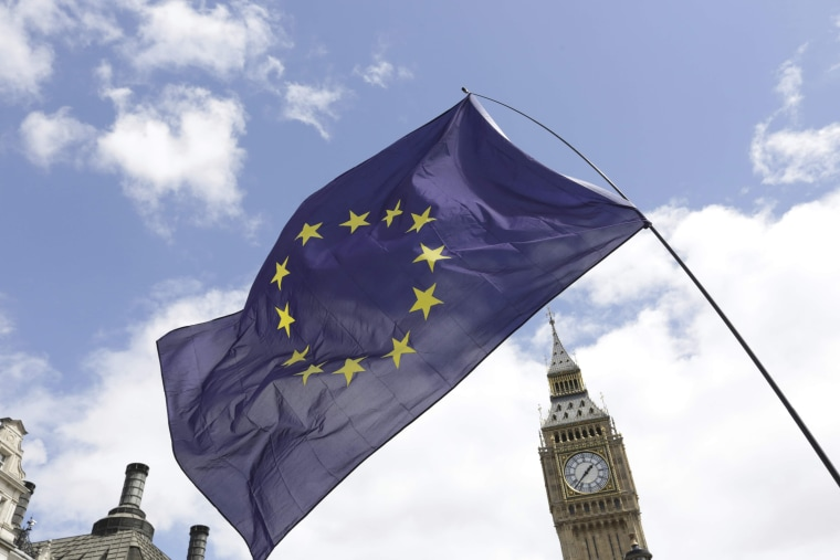 Image: A European Union flag is held in front of the Big Ben clock tower in Parliament Square during a 'March for Europe' demonstration against Britain's decision to leave the European Union, central London