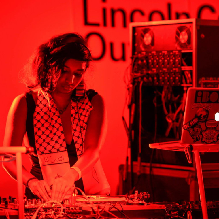 Thanu Yakupitiyage spinning at the 2014 Lincoln Center Out of Doors Festival
