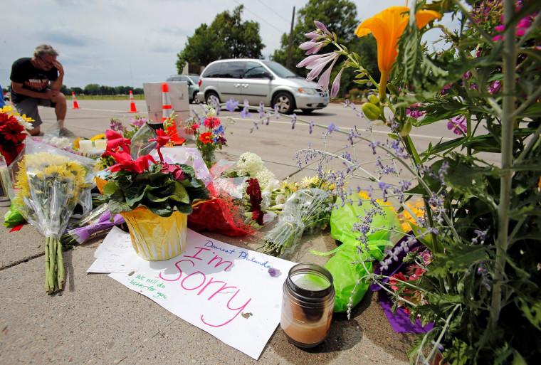 Image: Man kneels at shooting site of Philando Castile in Minnesota