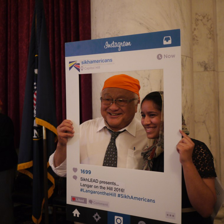 Rep. Mike Honda posing with a member of SikhLEAD during the 2016 Langar on the Hill.
