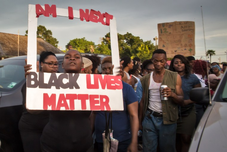 Image: People protest against the police shooting of Alton Sterling