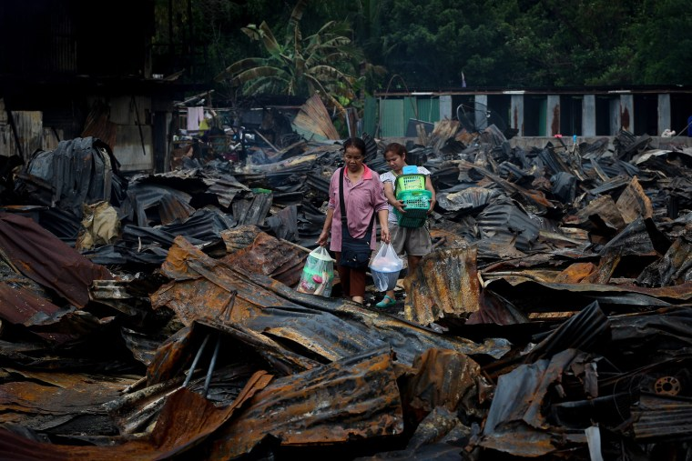 Image: A fire destroys a housing camp for construction workers employed by Italian-Thai Development PCL