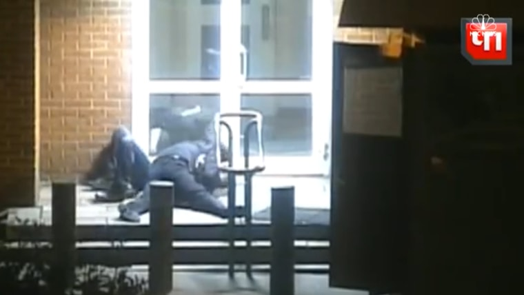 Screenshot of video showing Russian security agent grappling with a U.S. diplomat