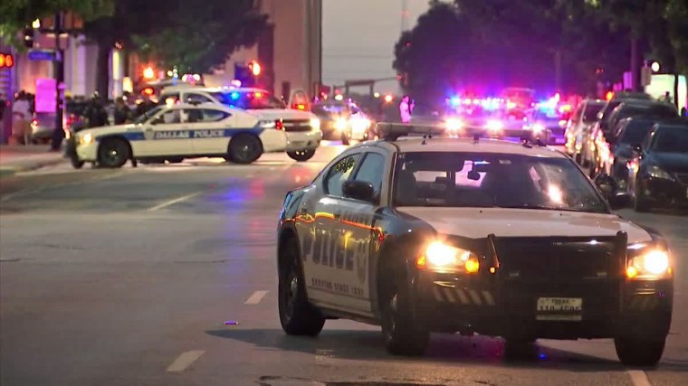 IMAGE: gunshots rang out following a protest and rally in Dallas held over police shootings