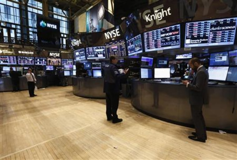Traders work on floor at New York Stock Exchange