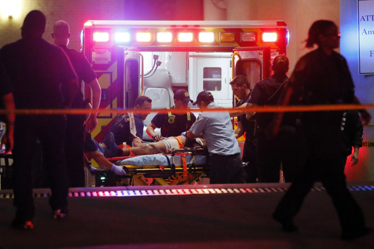 Image: Emergency responders administer CPR to an unknown patient