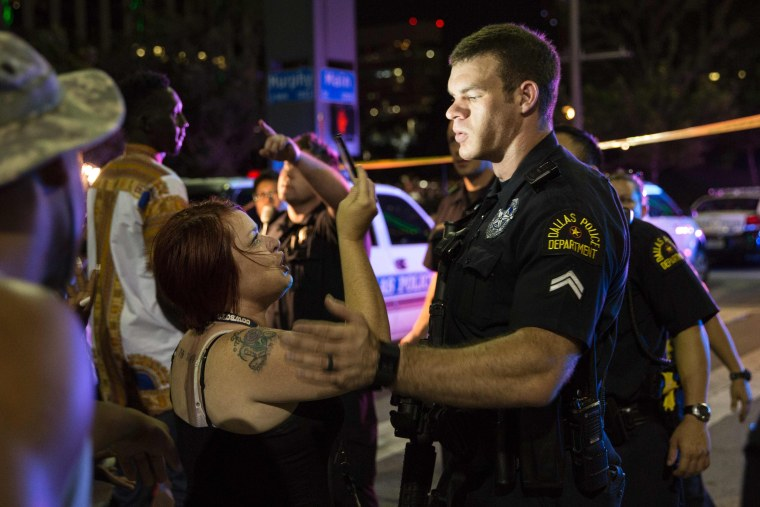 Image: Police attempt to calm the crowd as someone is arrested following the sniper shooting in Dallas