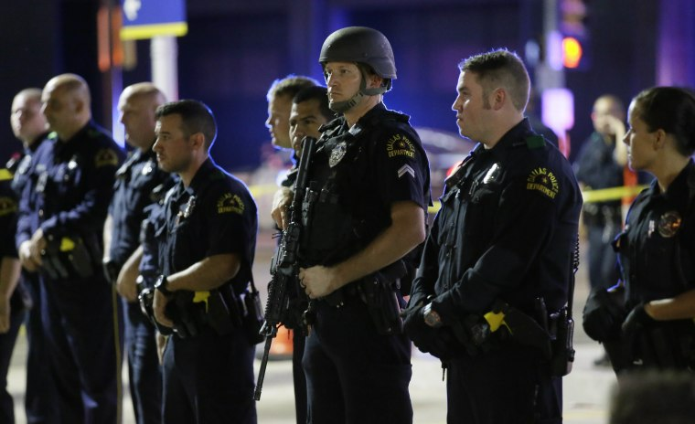 Image: Dallas police officers stand in a line near the site of shootings in downtown Dallas