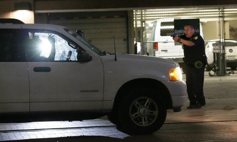 Image: Dallas police stop a driver in downtown Dallas
