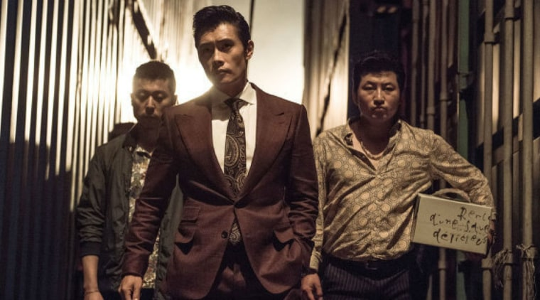 """The film """"Inside Men"""" portrays members of the political news media like Reporter Goh (featured right), portrayed by actor Kim Dae-Myung."""