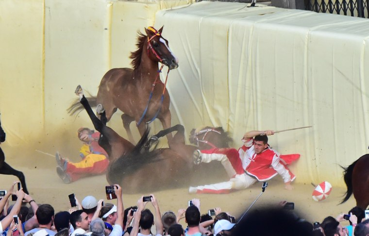 Image: TOPSHOT-ITALY-HORSERACING-TRADITION-PALIO