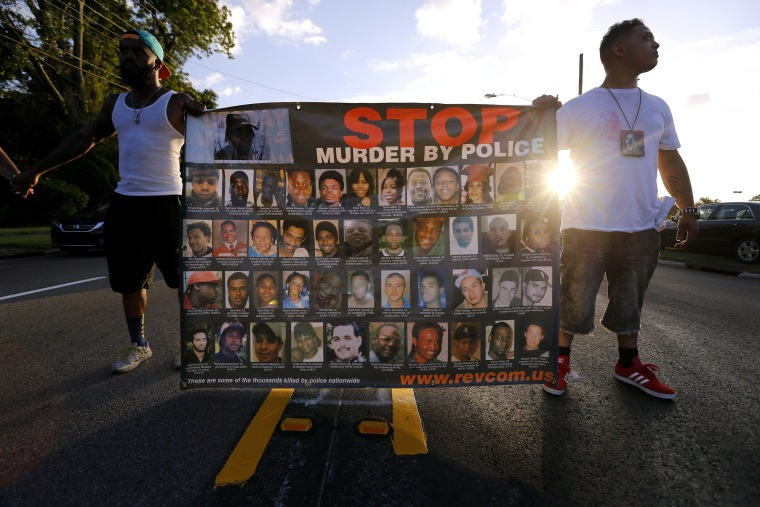 Image: A group of protesters demonstrate near a prayer vigil in memory of Alton Sterling, who was shot dead by police, in Baton Rouge, Louisiana