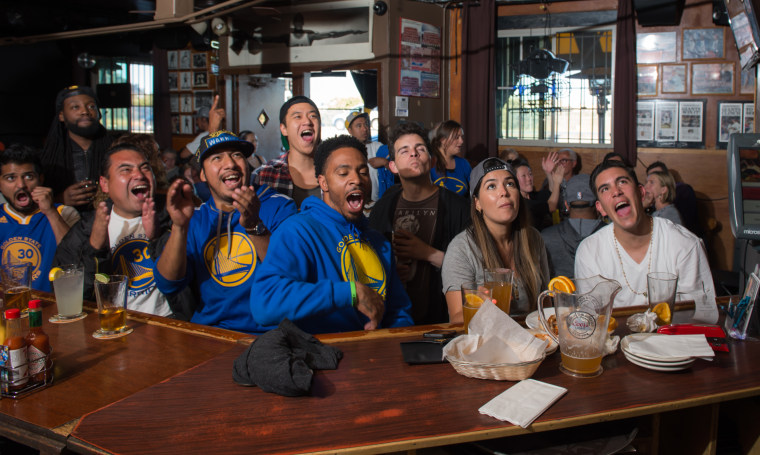 A large crowd comes together to watch sports at the 7 Mile House bar.