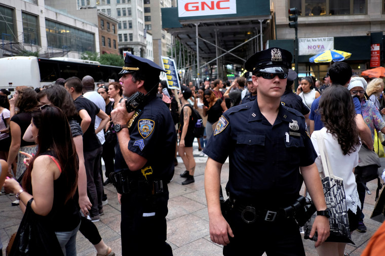 NYPD officers keep an eye on protesters as they take part in a protest against the killings of Alton Sterling and Philando Castile during a march in New York