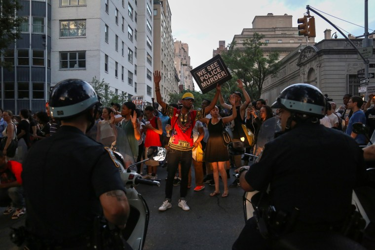 Image: Protesters, marching against the killing of Alton Sterling and Philando Castile, face police in Manhattan, New York