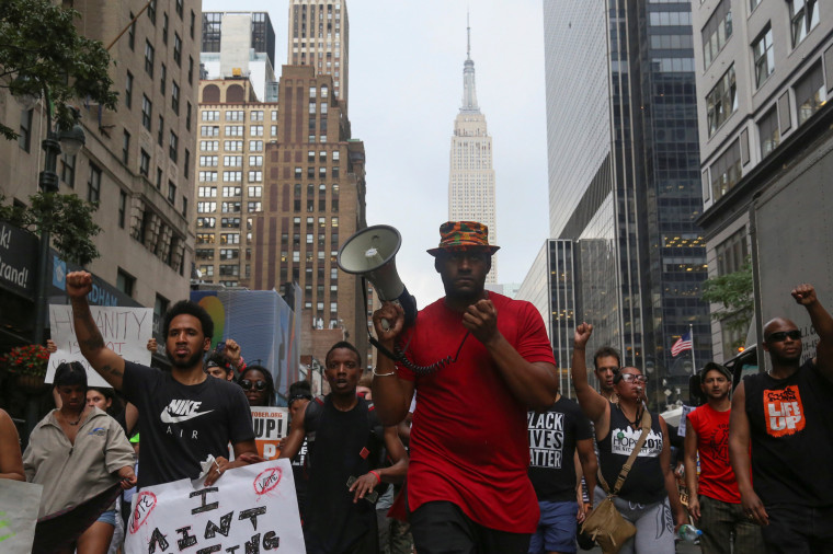 Image: The Empire State Building is seen in the background as protesters march against the killing of Alton Sterling and Philando Castile, in Manhattan