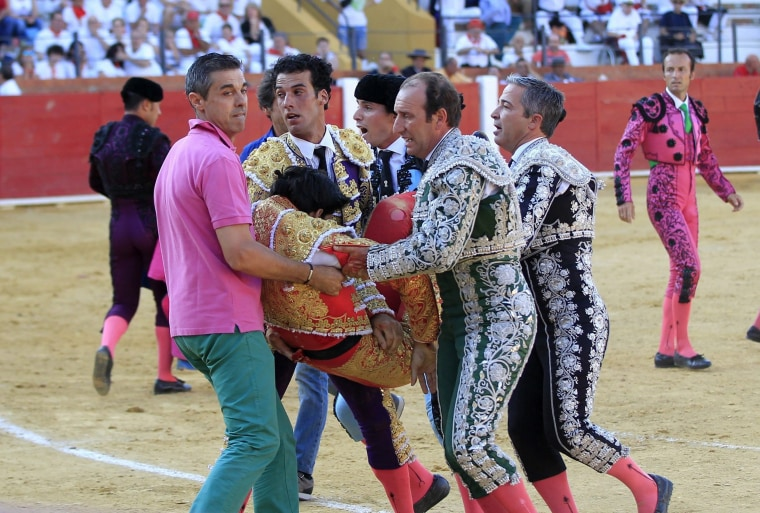 Image: Spanish bullfighter Victor Barrio, 29, is carried out from the bullring after being gored during a bullfight