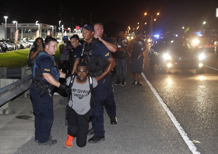 Image: Police arrest activist DeRay McKesson during a protest along Airline Highway
