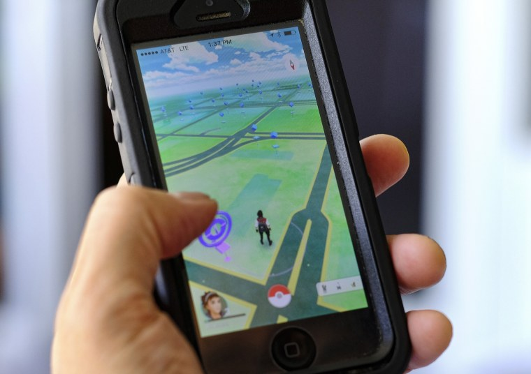 Image: Pokemon Go is displayed on a cell phone