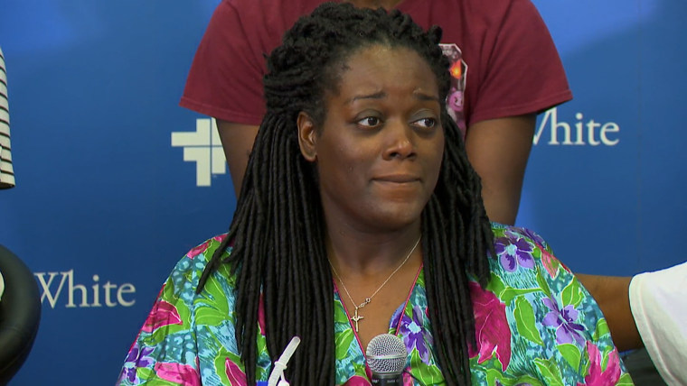 Shetamia Taylor, who was injured during the police ambush in Dallas, speaks at a news conference Sunday.