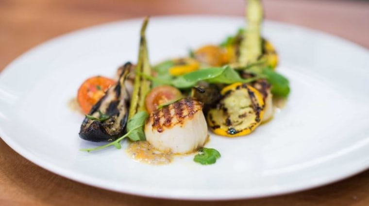 Geoffrey Zakarian makes buttery scallops with baby vegetables.