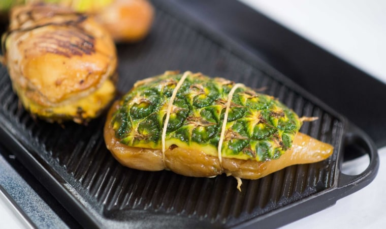 Grill chicken on pineapple
