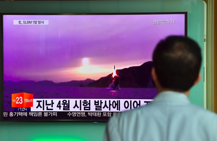 Image: A man watches file footage of a North Korean missile launch in Seoul on July 9, 2016