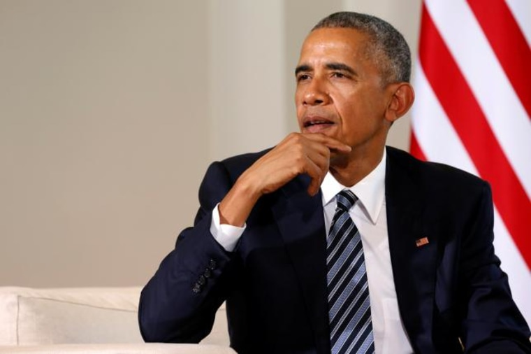 Obama answers a reporter's questions after meeting with Rajoy at the Palacio de la Moncloa in Madrid, Spain