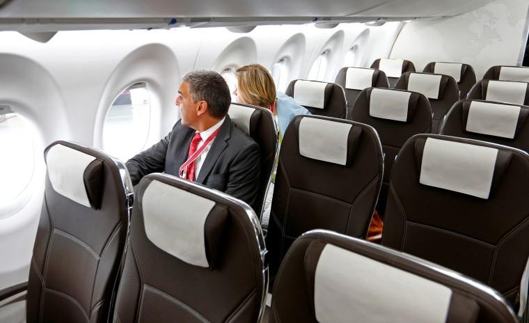Image: Journalists sit aboard Lufthansa unit Swiss International Air Lines new Bombardier CS100 aircraft at Zurich airport