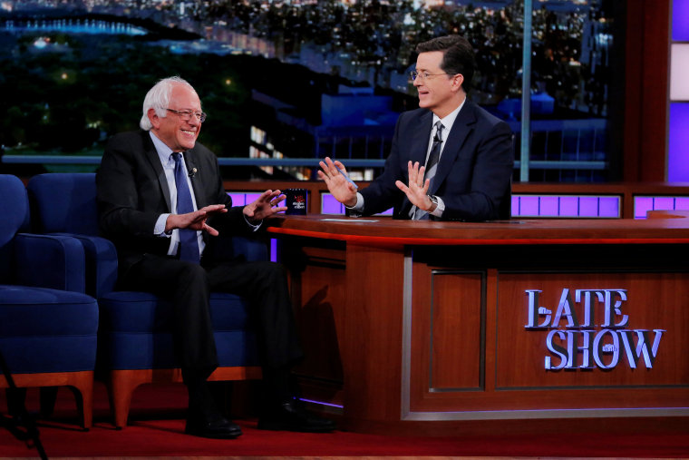 "Image: U.S. Democratic presidential candidate Bernie Sanders greets ""The Late Show"" host Stephen Colbert during a taping of the show in the Manhattan borough of New York"