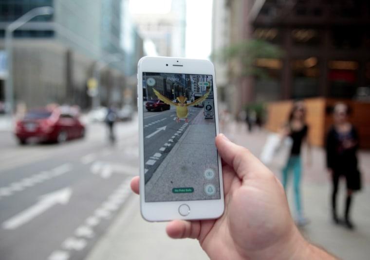 "Image: Photo illustration of a ""Pidgey"" Pokemon seen on the screen of the Pokemon Go mobile app"