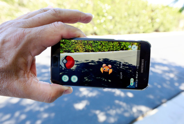 """Image: Illustration of the augmented reality mobile game \""""Pokemon Go\"""""""