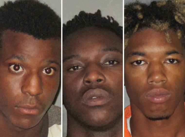 From left, Antonio Thomas, 17, Trashone Coats, 23, and Malik Bridgewater, 20.