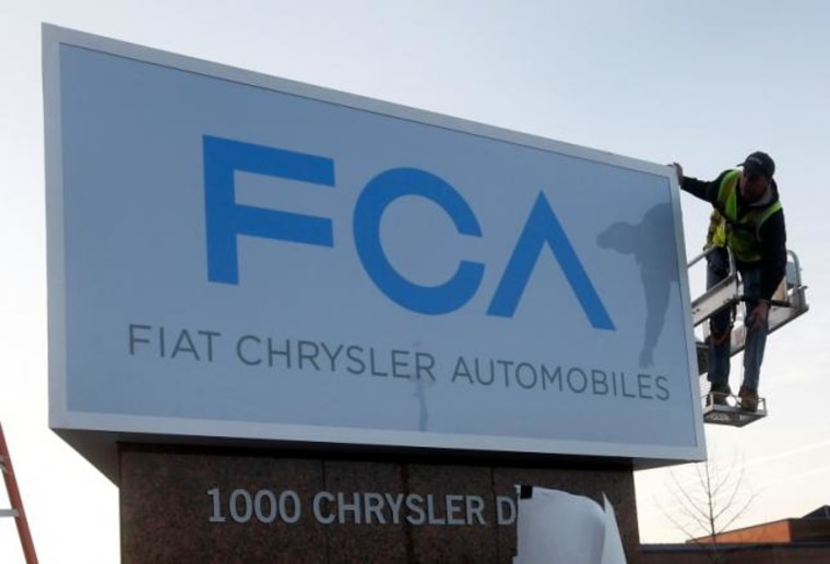 A new Fiat Chrysler Automobiles sign is unveiled at Chrysler Group World Headquarters in Auburn Hills, Michigan