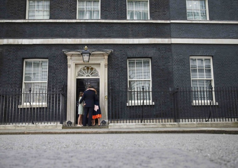 Image: Britain's outgoing Prime Minister, David Cameron, hugs his wife Samantha, daughters Nancy and Florence and son Arthur, in front of number 10 Downing Street, in central London