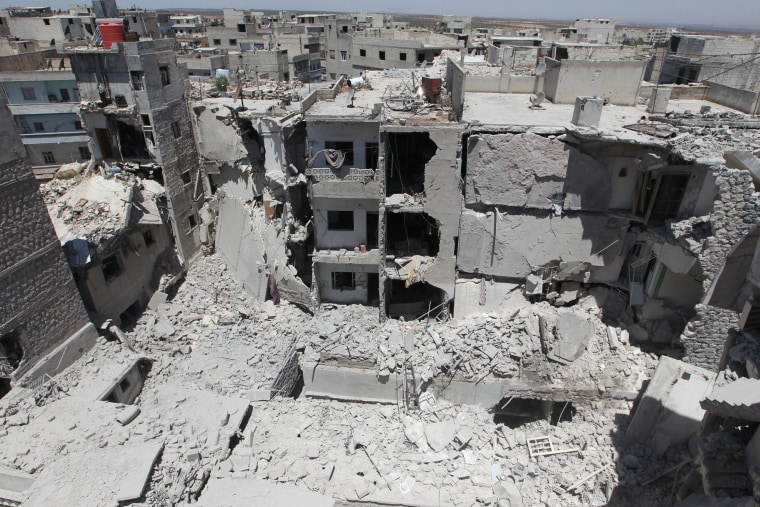 Image: Damaged buildings in revel-controlled Ariha, Syria, on July 13, 2016