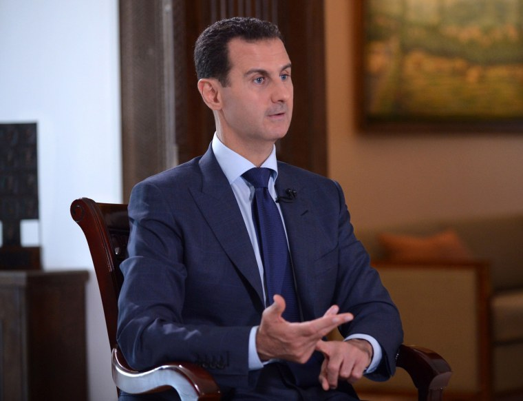 Image: Syrian President Bashar al-Assad speaking during an interview with American NBC News channel in the capital Damascus
