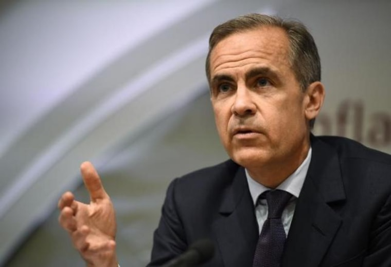 Governor of the Bank of England Mark Carney delivers his monthly inflation report at the Bank of England in the City of London