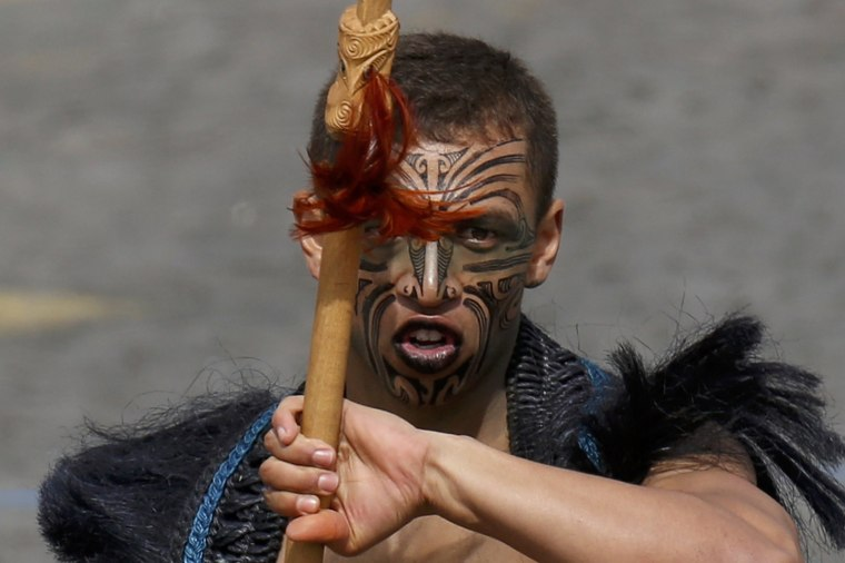 Image: A Maori warrior from New Zealand takes part of the traditional Bastille Day military parade on the Champs-Elysees in Paris