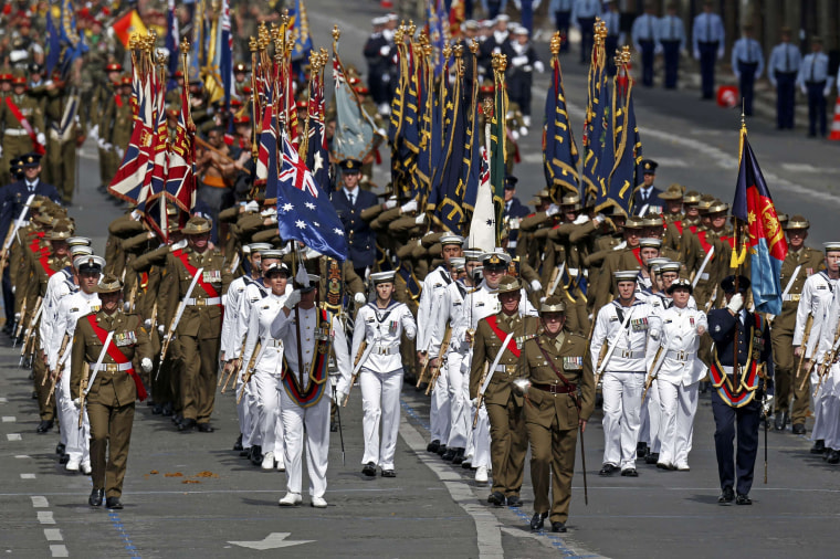 Image: Troops from Australia and New Zealand attend the Bastille Day military parade on the Champs-Elysees in Paris