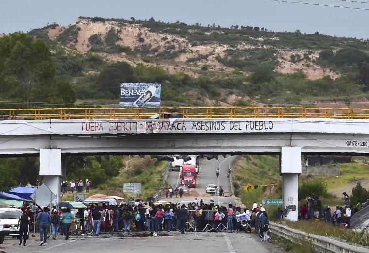 Teachers block a road at the entrance of the village of Nochixtlan, Oaxaca State, Mexico on July 4, 2016.