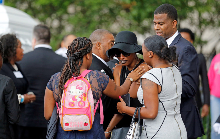 Image: Family and friends of Castile mourn outside Cathedral in St. Paul