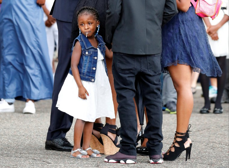 Image: Diamond Reynolds' daughter looks on as the funeral procession for Philando Castile travels from the Brooks funeral home to the St Paul Cathedral in St Paul, Minnesota