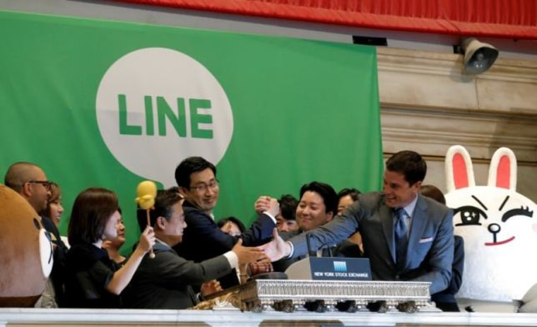 NYSE president Tom Farley congratulates Japan's Line Corp. CFO In-Joon Hwang and Chief Global Officer Joongho Shin and Chief Strategy and Marketing Officer Jun Masuda after ringing the opening bell to celebrate the company's IPO at the NYSE