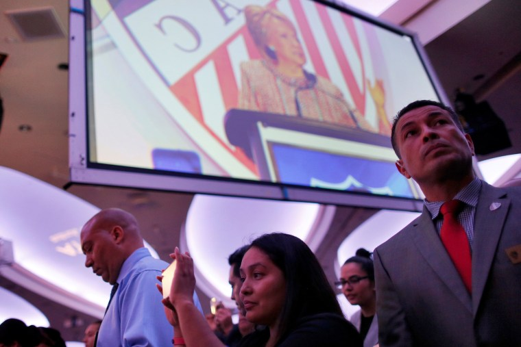 Image: People listen as Democratic U.S. presidential candidate Hillary Clinton speaks at the League of United Latin American Citizens (LULAC) during a campaign stop in Washington