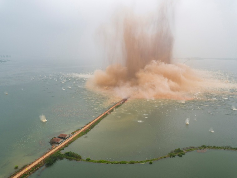 Image: A dike between two lakes is seen under demolition in Wuhan